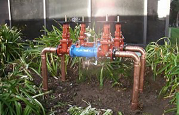 Backflow device being installed above ground