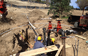 Backflow device being installed underground