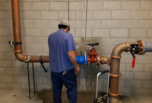 Worker checking on backflow
